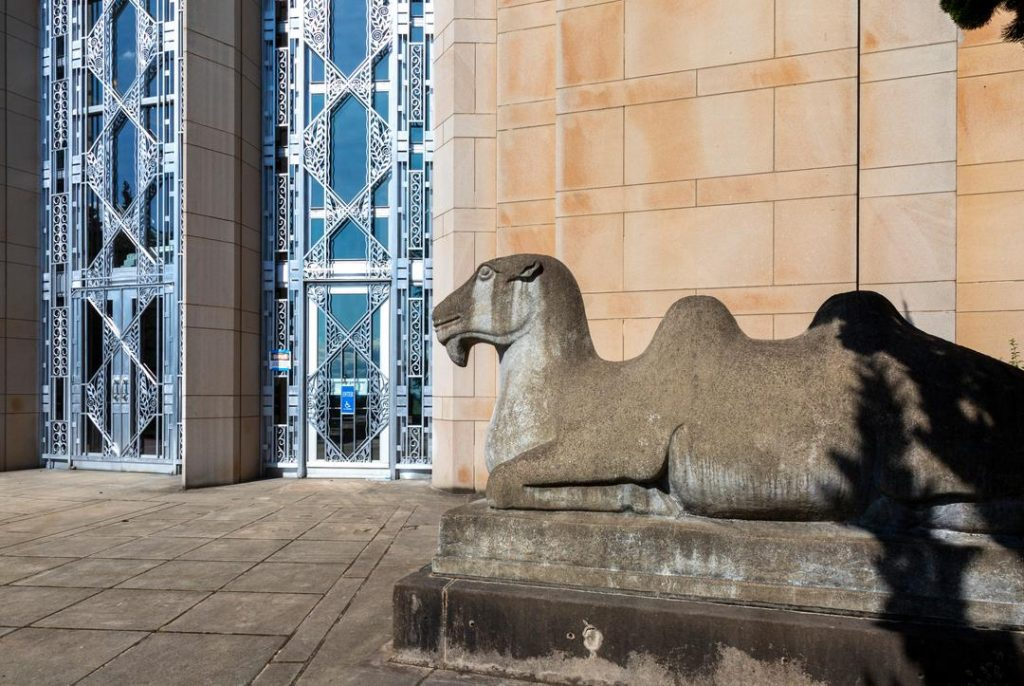 Asian Art Museum camel in front of the building's Art Deco doorway